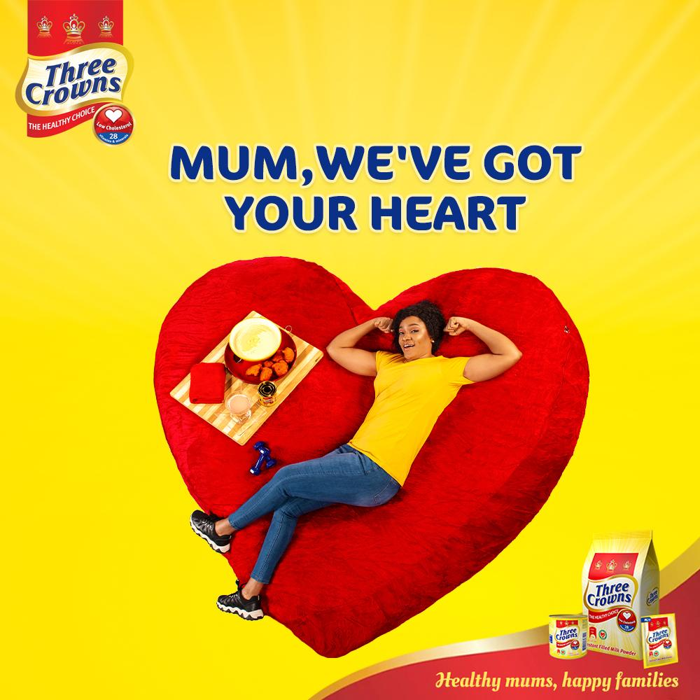 A fit mum on a heart shaped bed with breakfast on bed with Three Crowns